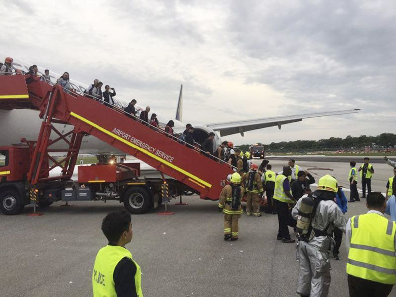Passengers disembark after the fire. Photo: AAP.