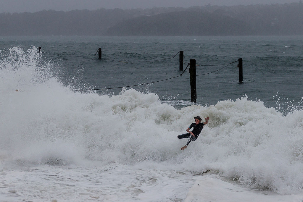 A surfer wipes out on a wave at Shark Beach, Vaucluse. Photo: Getty.