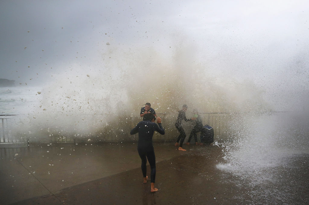 Local children are soaked by huge waves at Bronte Beach.