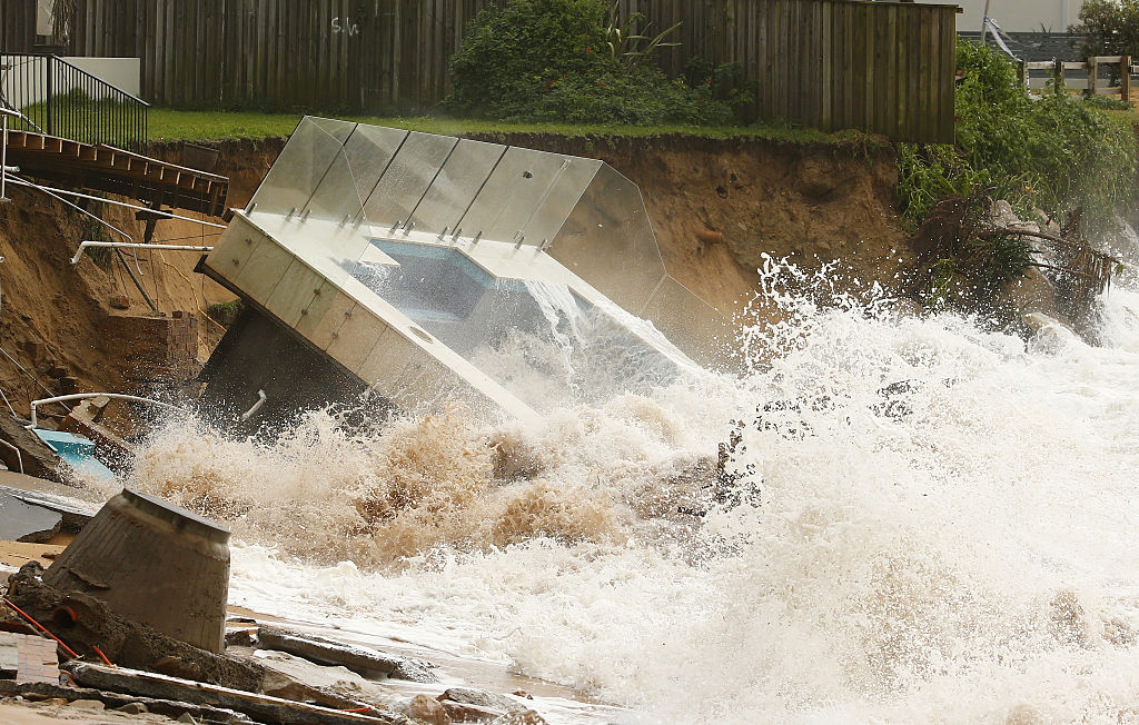The moment when an inground pool falls into the sea on Sydney's northern beaches. Photo: Getty.