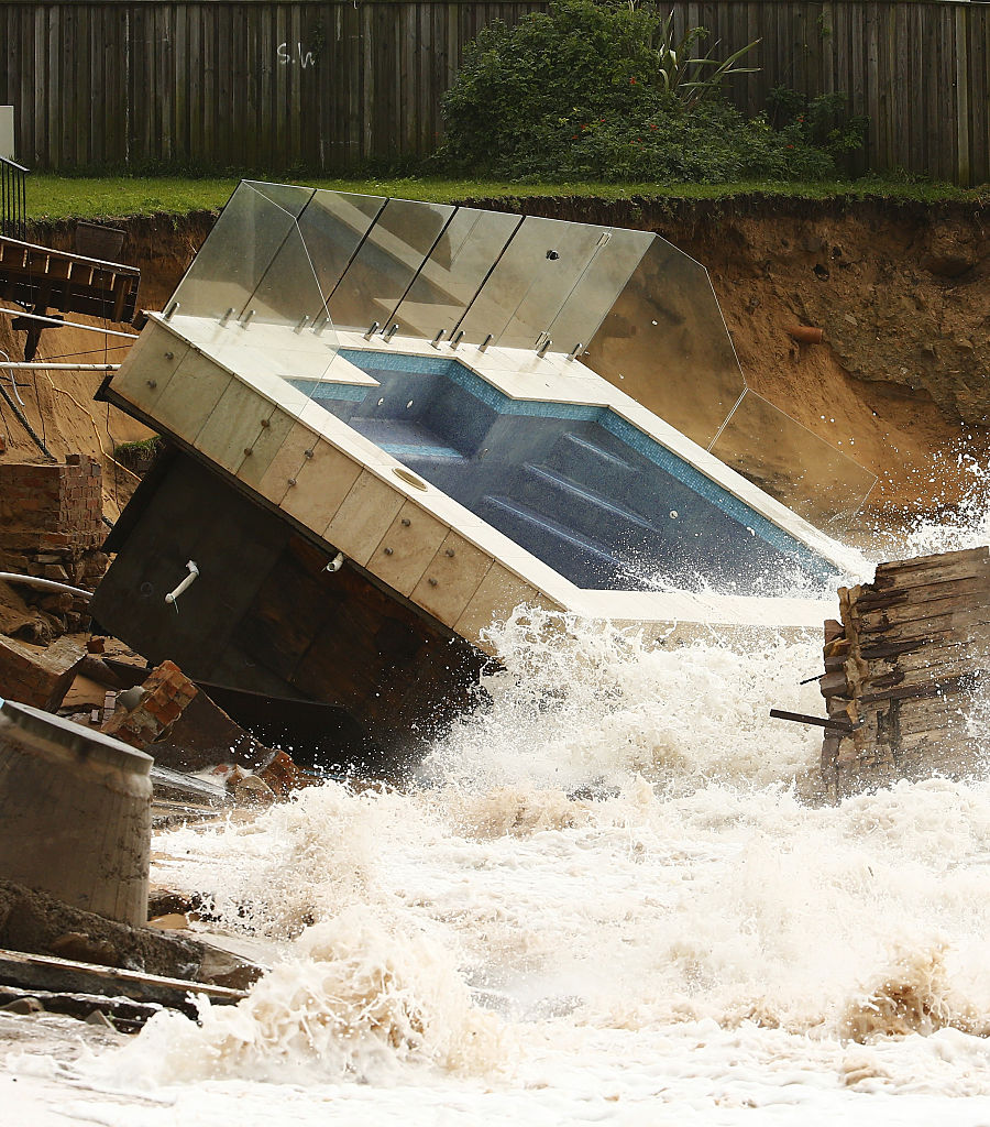 A destroyed pool is hit by big waves after torrential rains.