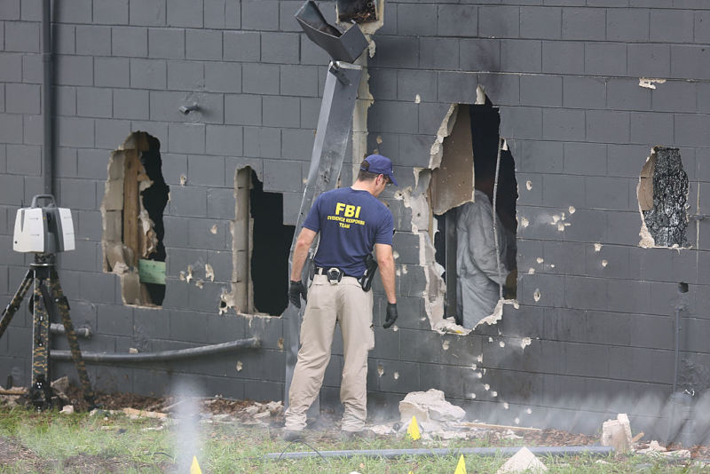 Holes in the wall of the nightclub through which police tried to gain access. Photo: Getty.