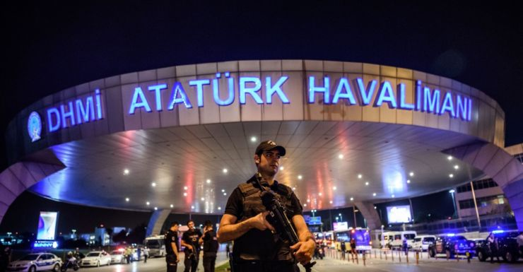 A Turkish riot police officer patrols Ataturk airport in Istanbul.