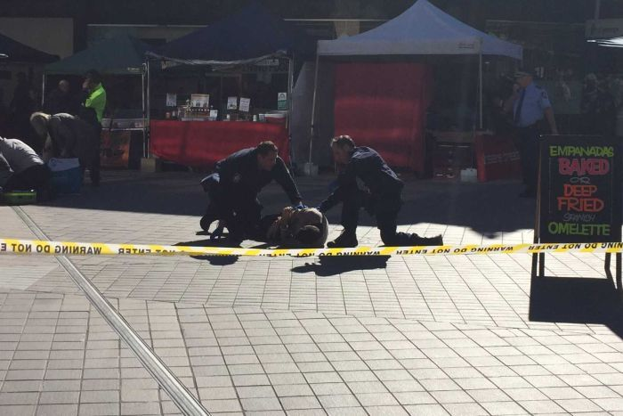 Man shot by police at Hornsby market lies on the ground