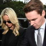 Oliver Curtis and wife Roxy Jacenko arrive at court on Friday.
