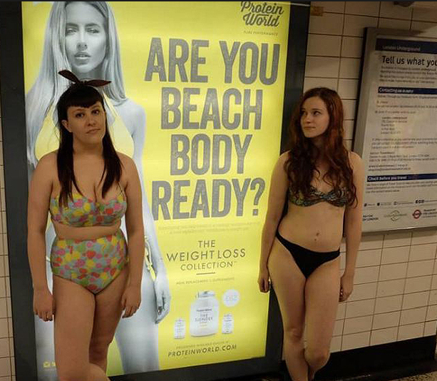 Women protesting the 'sexist' ad in the London Tube. Photo: Twitter