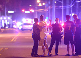 Family members are directed away from the nightclub. Photo: AP