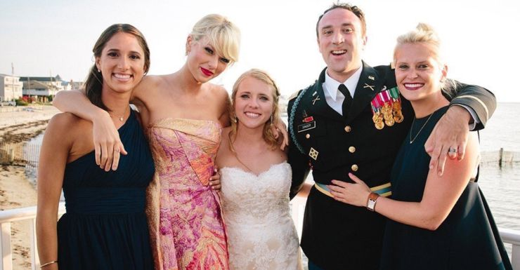 Taylor Swift with surprised guests at a California wedding.