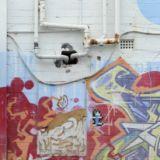 A Banksy artwork in Prahran has pipes put through it in 2012.