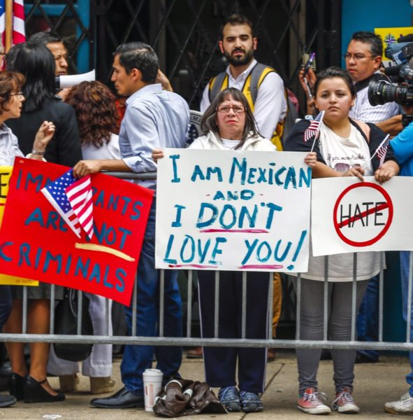Members of the Mexican community protest against Donald Trump in Chicago. Photo: AAP.