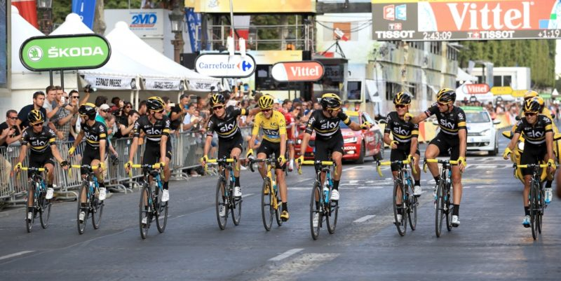 Chris Froome crosses the finish line on the Champs-Elysees avenue with his team-mates to win the Tour de France.