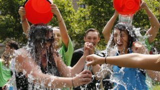 Two women get doused during the ice bucket challenge to raise funds and awareness for ALS.