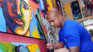 Myuran Sukumaran in 2015 painting at a prisoners studio in Kerobokan prison.