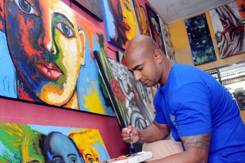 Myuran Sukumaran in 2015 painting at a prisoners studio in Kerobokan prison.