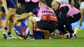 Mitch Wallis looked in agony as he was taken from the field with a broken leg.