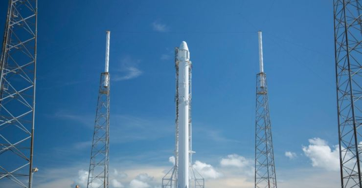 SpaceX Falcon 9 rocket attached to the Dragon cargo capsule.