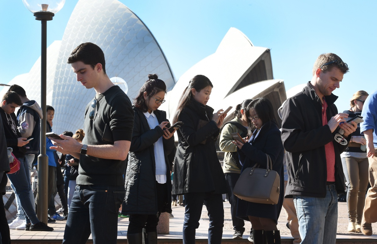 Pokemon Go players swarm the Sydney Opera House. Photo: Getty