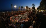 People gather at a makeshift memorial on the Promenade des Anglais in Nice.