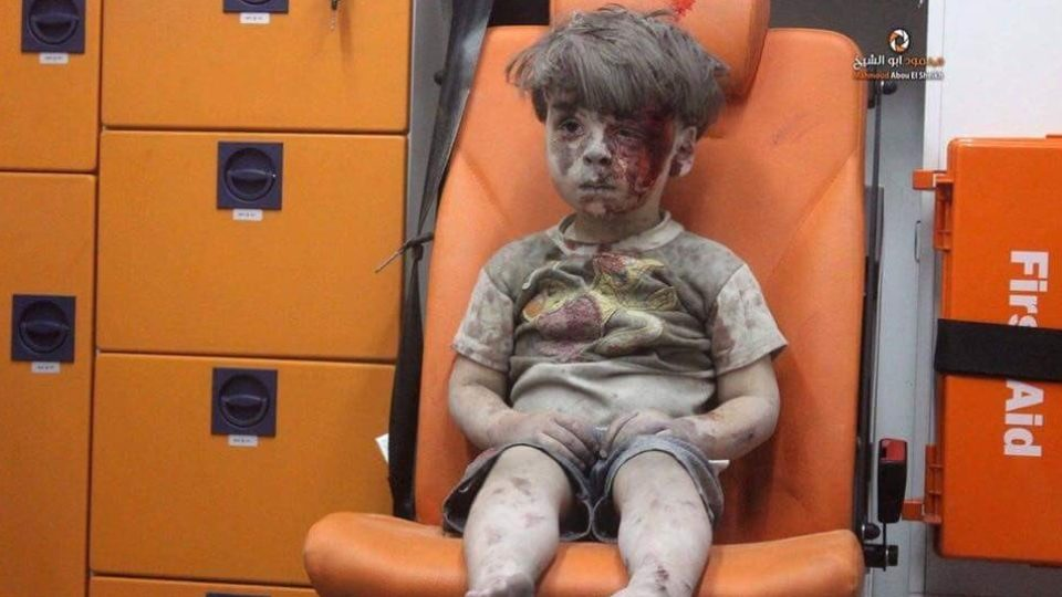 Haunting image of Syrian boy saved from Aleppo rubble