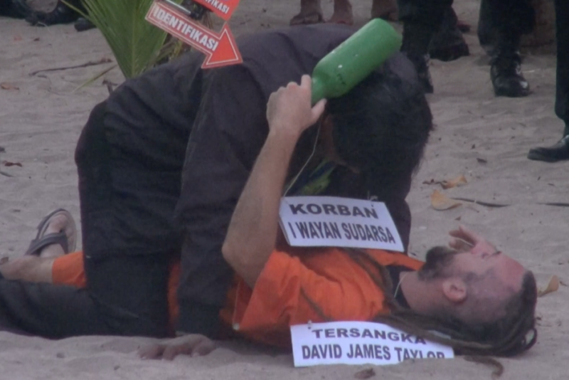 Taylor during a re-enactment of the night he and partner Sara Connor allegedly murdered a Bali police officer.