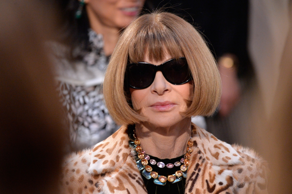 Anna Wintour uses black sunglasses to hide her general disdain. Photo: Getty