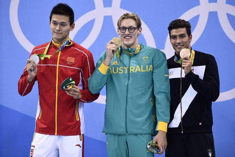 Horton on the podium with silver medallist Sun Yang and bronze medallist Grabriele Detti from Italy.