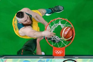 Australia's Aron Baynes dunks against Lithuania during the quarterfinal match. Photo: Getty/pool