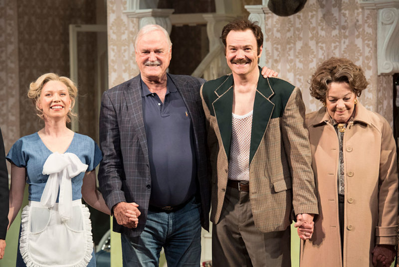 John Cleese hugs on stage with Stephen Hall who played Basil Fawlty after their opening night at The Rosyln Packer Theatre on August 20