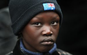 A South Sudanese boy wearing an Australian hat at a Melbourne rally. Photo: William West/AFP/Getty