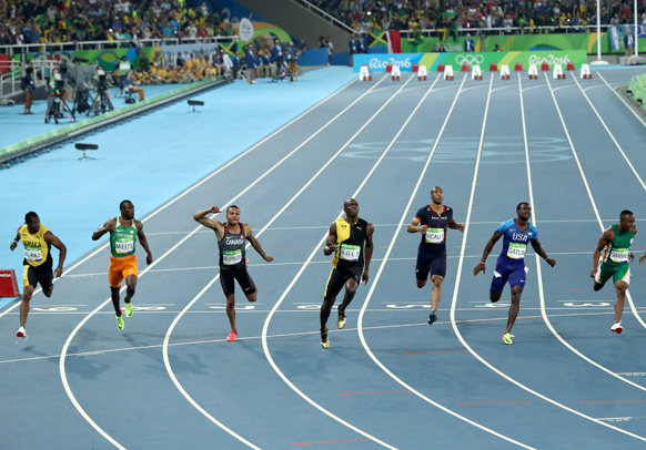 Bolt crosses the line first. Photo: Getty