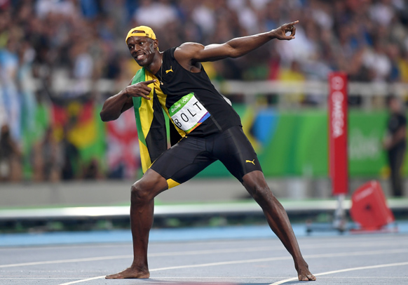 Bolt celebrates in trademark fashion. Photo: Getty