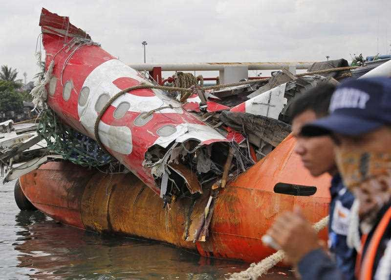 remains of the fuselage of the ill-fated AirAsia Flight 8501 on the deck of rescue ship Crest Onyx at Tanjung Priok port in Jakarta, Indonesia, Monday, March 2, 2015. The Airbus A320-200 with 162 people on board crashed into the Java Sea on Dec. 28, 2014 while flying from Surabaya, East Java, to Singapore.