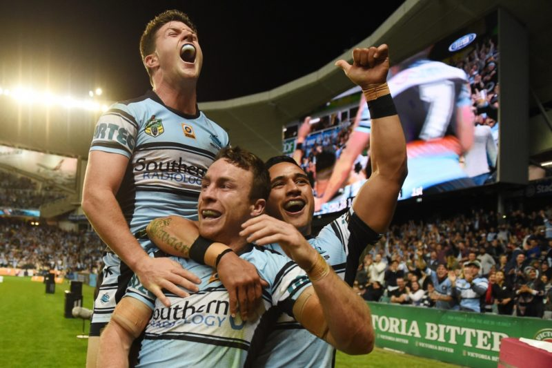 Cronulla's James Maloney celebrates his run-away try with Chad Townsend and Valentine Holmes during the NRL preliminary final against North Queensland