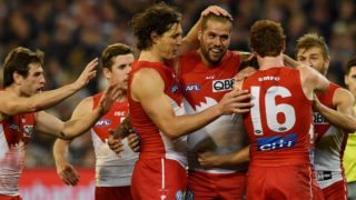 Sydney Swans teammates swamp Buddy Franklin after a goal against Geelong in the preliminary finalat the MCG.