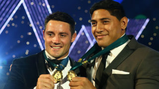 Storm star Cooper Cronk and Cowboys' Jason Taumalolo pose with their medals.