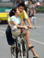 Chinese couple bicycle