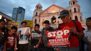 Activists hold a candlelight vigil last September for victims of drug killings. Photo: Getty