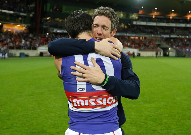 Injured skipper Robert Murphy hugs Easton Wood after the Dogs' win over the Giants.