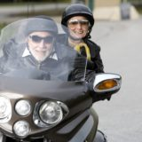 retirees on a motorbike