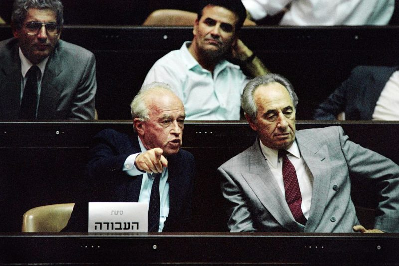 Yitzhak Rabin (L), sitting next to Shimon Peres in the Knesset in 1992.