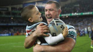 Gallen celebrates Cronulla's preliminary final win with his son.