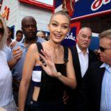 Gigi Hadid was manhandled while walking through a crowd of photographers.