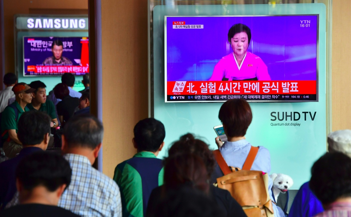 People in a train station in Seoul, South Korea, pause to watch North Korea's announcement of a fifth nuclear test. Photo: Getty