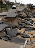 An official vehicle surveys the damage to Highway A1A.