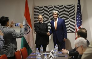 US Secretary of State John Kerry shakes hands with India's Minister of Environment, Forest and Climate Change Shri Anil Madhav Dave in Kigali.