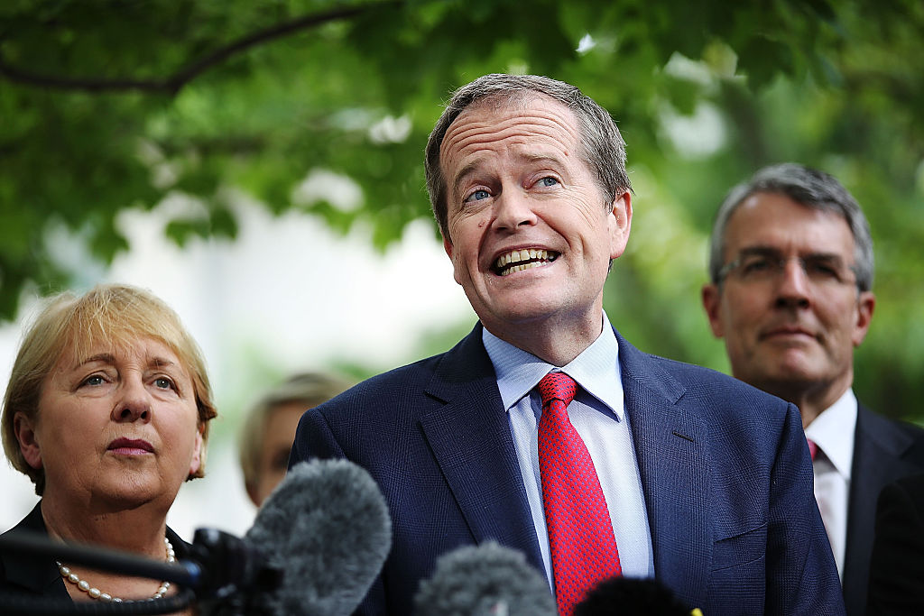 CANBERRA, AUSTRALIA - DECEMBER 04: Opposition leader Bill Shorten and his colleagues speak to the media during a press conference to reflect on 'Tony Abbott's Year of Broken Promises' at Parliament House on December 4, 2014 in Canberra, Australia. Today is the official last day of sitting at Parliament for 2014. Parliament will return on February 9, 2015. (Photo by Stefan Postles/Getty Images)