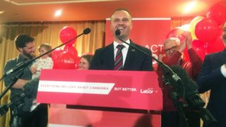 Andrew Barr, flanked by his family, claims victory after the ACT election.