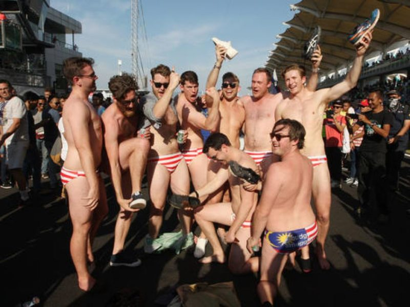 The men stripped down to Malaysian flag-printed swim briefs at the Formula One.