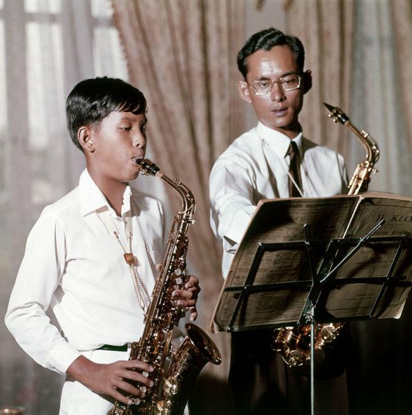 King Bhumibol and Prince Vajirlongkorn playing the saxophones.