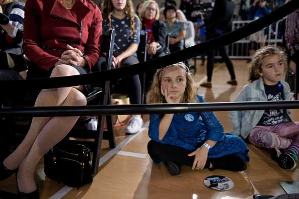 Young girls listen to Clinton's question and answer session. Photo: Getty